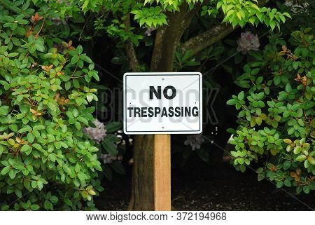 No Trespassing Sign Posted In Nature Outside.