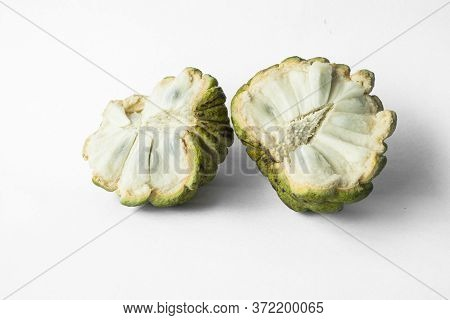 Sugar Apple Fruit Half Cutted, Rough Scaly Green Skin And White Plump, Isolated On White Background,