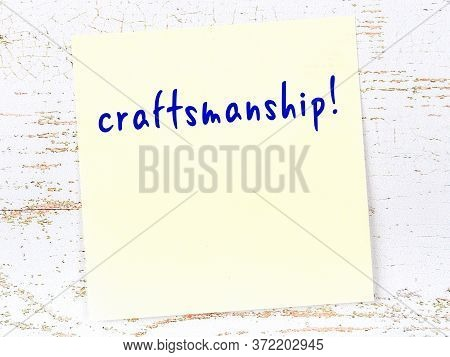 Yellow Sticky Note On Wooden Wall With Handwritten Inscription Craftsmanship