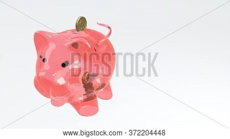 Coins Fall Into A Pink Glass Piggy Bank - A Symbol Of Wealth, Frugality And Effective Investment Pla