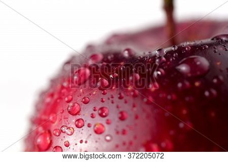 Close-up Of Red Apple With Water Drops