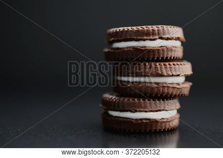 Close-up Of Chocolate Cookies On A Black Background