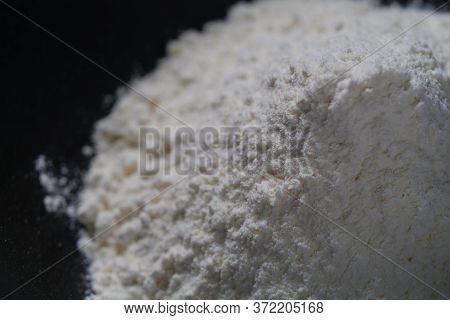 Closeup Of A Flour On Black Bowl