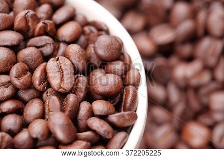 Roasted Coffee Beans In A Coffee Cup
