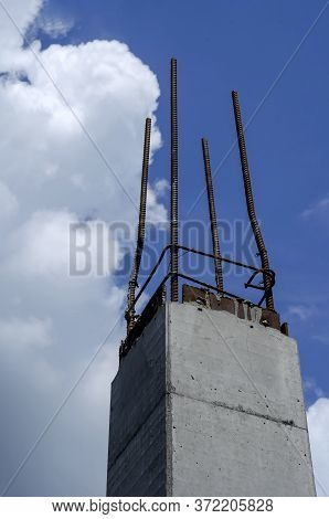 Concrete Pile With Reinforcement Against The Sky. The Construction Of A Modern Building On The Found
