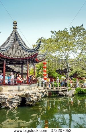 Suzhou, China - 26 April, 2011:  Tourists Visit The Lion Grove Garden. It Is Recognized With Other C