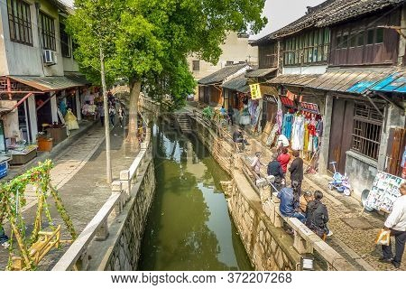 Suzhou, China - 4 April, 2011: People Walking In Suzhou Market Street. Suzhou Is Often Dubbed The