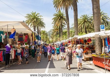 Ventimiglia, Italy- 8 June: People Walking On The Market Street. The Famous Market Happens Every Fri