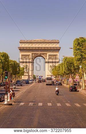 Paris, France - 9 September, 2012:  The Champs-Élysées And The Arc De Triomphe. The Most Famous Aven