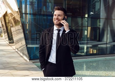 Businessman Talking On Phone Isolated. Business Man Standing Full Length With Phone In Hand