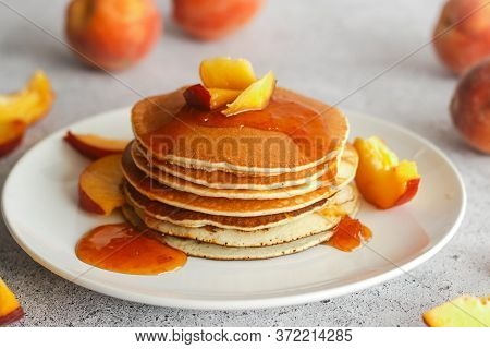 Pancakes With Apricot Jam And Peaches. Pancakes On A Plate. Tasty Breakfast