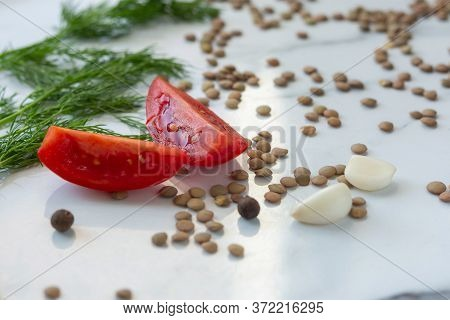 Ingredients For Lentil Soup. Red Bell Peppers, Lentils, Onions,garlic, Spices And Tomatoes On The Ta