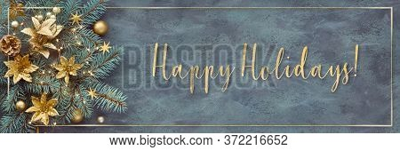 Gilded Text Happy Holidays. Christmas Or New Year Panoramic Background - Fir Twigs Decorated With Go