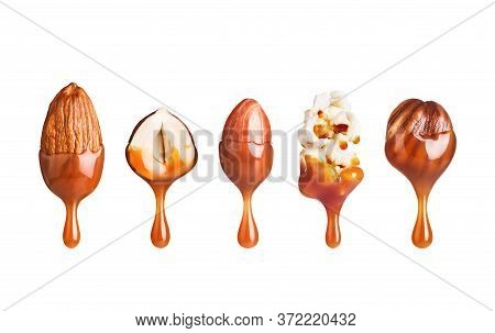 Various Nuts With Caramel Drops  Isolated On White Background