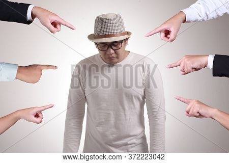 Sad Anxious Asian Man Judged By Different Hands. Concept Of Accusation Of Guilty Person, Bully Harra