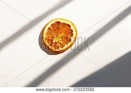 Dried Orange Slice In Intence Sunlight, Sunburn Warning, Dry Skin, Drying Danger