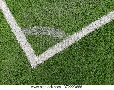 A Corner Arc Marking On Green Grass Pitch