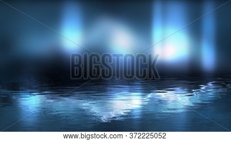 Night Scene With Reflection Of Neon Light In The Water. Liquid, Puddles, Flooding. Rays And Lines In