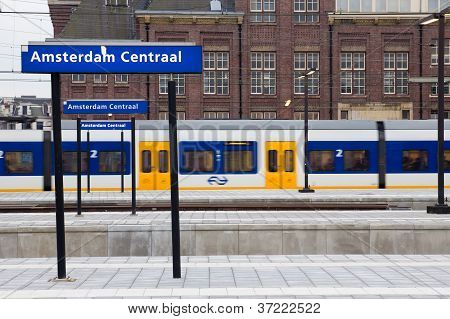 Dutch train arriving at Amsterdam Central Station poster