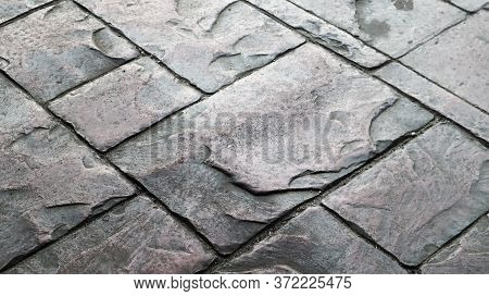Concrete Or Cobblestone Gray Paving Slabs Or Stones For The Floor. Pavement In The City. Large Gray