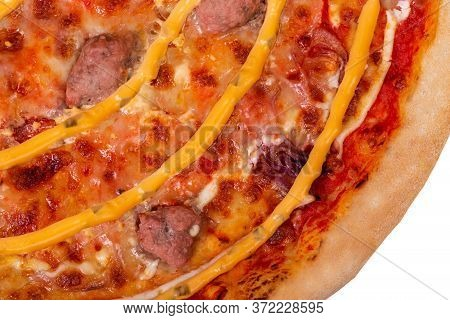 Tasty Salsiccia Pizza With Beef Sausages, Mozzarella, Various Sauces And Marinated Red Onions, Close