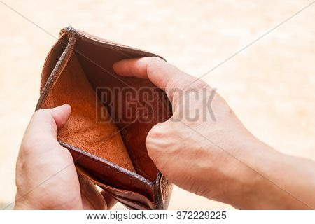 Purse With No Money At All, Empty Wallet In The Hands Man, No Money In Pocket, Close-up No Money In