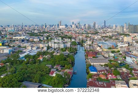 Aerial View Of Chao Phraya River, Bangkok Downtown Skyline. Thailand. Financial District And Busines