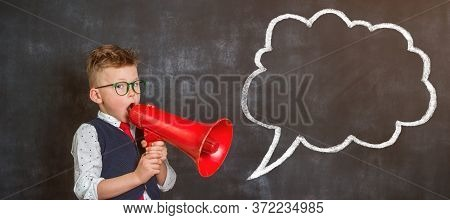 Schoolboy Shouting Through Loudspeaker. Pupil From Primary School Shouting In Retro Vintage Red Mega