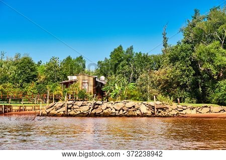 Lush Vegetation, Wooden House And Pier. Tigra Delta In Argentina, River System Of The Parana Delta N