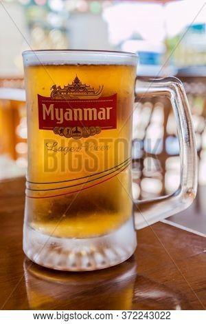 Pyin Oo Lwin, Myanmar - November 29, 2016: Cold Glass Of Myanmar Beer In A Restaurant In Pyin Oo Lwi