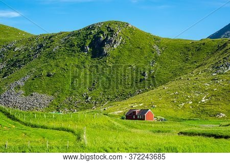 Mountains And Farmstead On The Lofoten Islands In Norway.