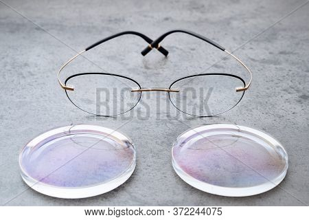 Closeup Of Fashion Trendy Eyeglasses Lying On Table In Optical Store With New Lenses. Professional P