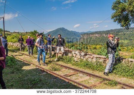 Gokteik, Myanmar - November 30, 2016: Tourists Take Photos Of Gokteik Viaduct From A Local Train Sta