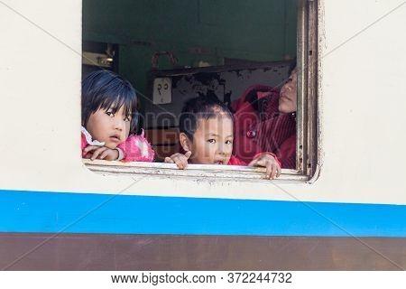 Gokteik, Myanmar - November 30, 2016: Children In A Train Near Gokteik Gok Teik Viaduct, Myanmar