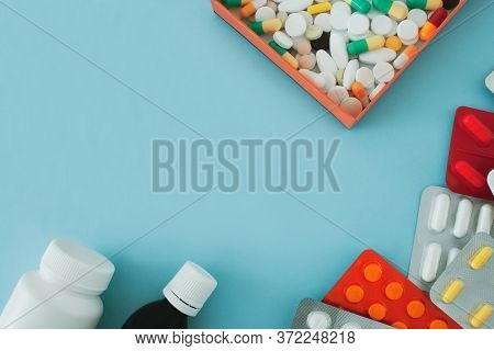 Colorful Tablets And Capsules In An Orange Box, Antiseptic Bottle, Container, Tablets In A Package A