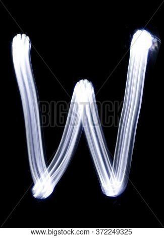 Handwrite Letter W, Made With Light Painting Technic Isolated On Black. Light Effect Font Of Full Al