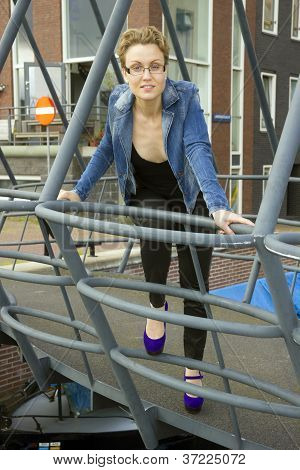 Portrait Of Cute Smiling Young Woman On The Bridge