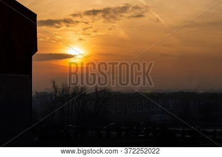 Beautiful Sunset Scenery Over The City, Orange Sky And City Silhouette Background.
