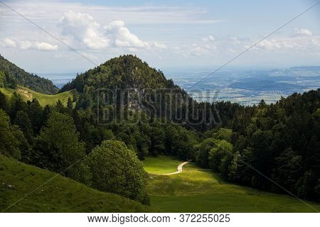 A Picturesque Forest Landscape With Green Hills And Mountain Ranges.