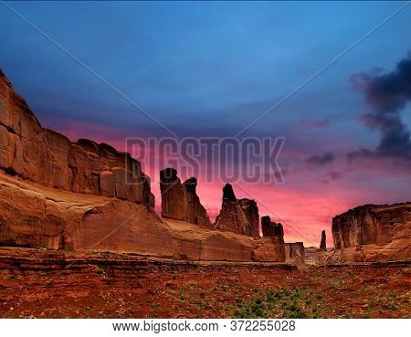 Natural Arches On The Background Of A Fantastic Sunset. Arches, Usa.