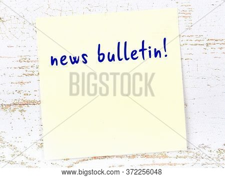 Concept Of Reminder About News Bulletin. Yellow Sticky Sheet Of Paper On Wooden Wall With Inscriptio