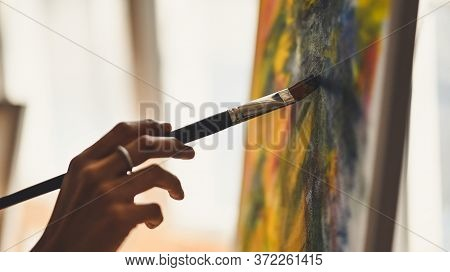 Cropped Image Of Artist Woman's Hand Drawing An Oil Color On Canvas By Paint Brush At The Modern Art