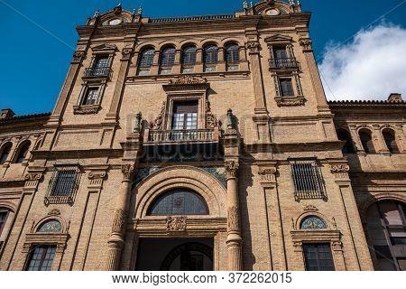 Seville, Spain - October 20, 2019: Close Low Angle Shot: Main Building Of Plaza De Espana Moorish Revival Architecture On A Sunny Day.