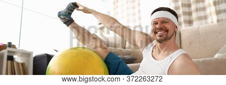 Man At Home Doing Fitness With Dumbbells And Ball. An Effective Set Of Exercises At Home. Strength A