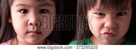 Portrait Half Face Of Asian Sibling Child Girls With Sad And Angry Expression On Dark Background.
