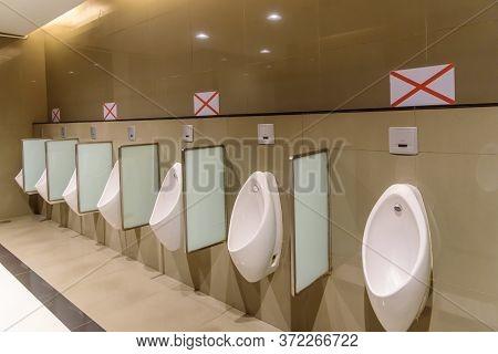 Social Distancing In Toilet / Cross Sign At Chamber Pot For Social Distancing