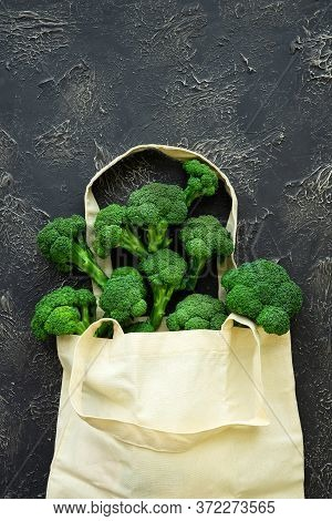 Beige Grocery Bag With Green Broccoli Florets On Black Background