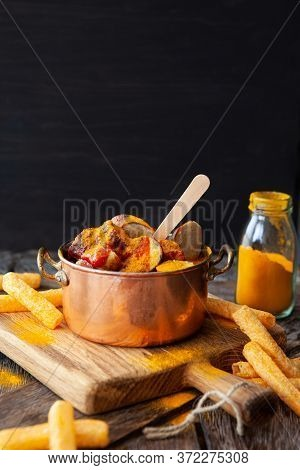 Delicious Bratwurst With A Spicy Tomato Curry Sauce