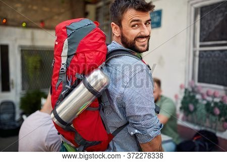 Young handsom adventurer posing for a photo