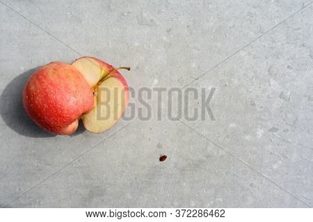 Cutting An Apple Fresh Fruit Preperation Inside A Kitchen On A Chopping Board